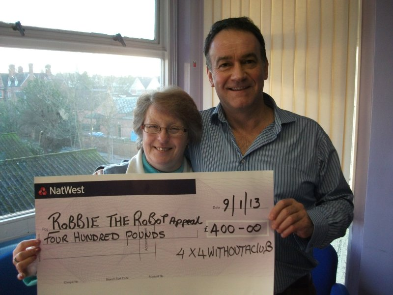 Steph Awbery presenting a cheque to Mark Goff